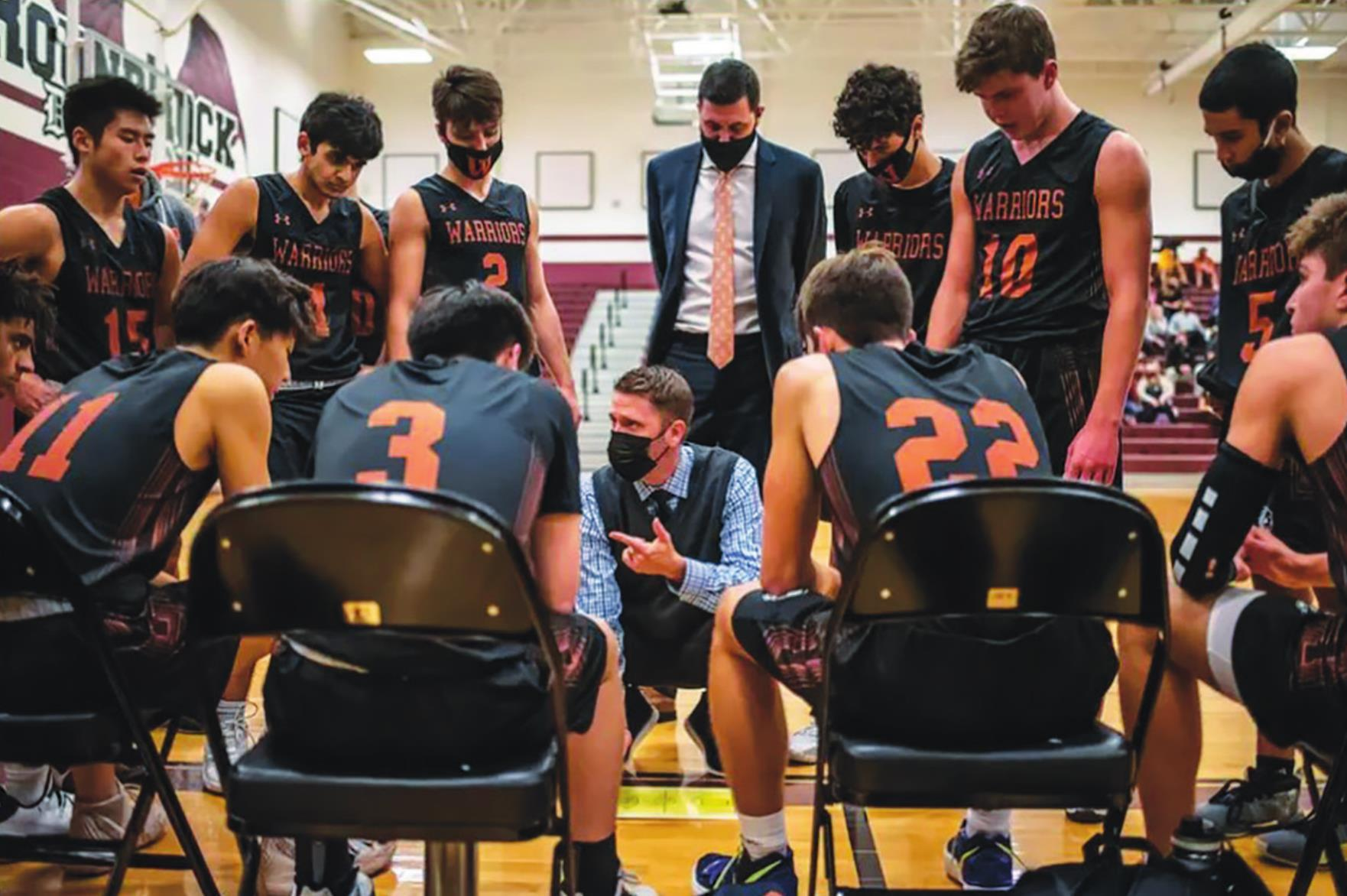 Westwood High School head basketball coach Brad Hastings speaks to his team during a time out at game. Hastings said many of his students have trained most of their lives, and it'd be a shame if the seniors didn't have the opportunity to play. Photo b