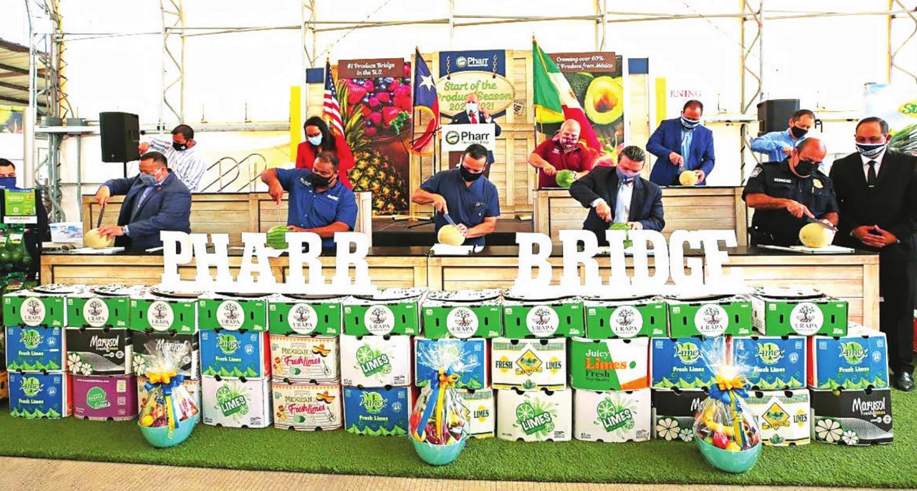 Traditional Cutting of the Fruit - Mayor Ambrosio Hernandez, M.D., and special guests including Texas State Representative Sergio Muñoz, Jr., Chairman of the Pharr International Bridge Board Edgar Delgadillo, Vice-Chairman of the Pharr International Brid